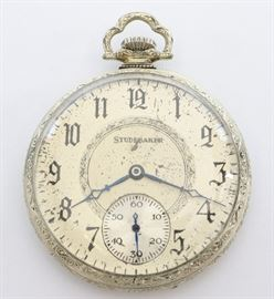"South Bend ""Studebaker"" Pocket Watch -  South Bend ""Studebaker"" model 1 pocket watch.  12 size, 21 j, Adj 8 pos, DR, SW, LS, S. W. C. Co. 14k White GF, OF, Silvered SSD w/Arabic numerals. Serial #1195515.  Some wear, dial wear. Winds, sets and running when cataloged."