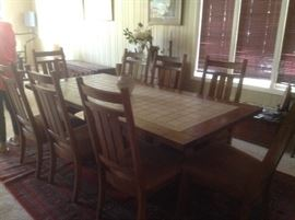 "This dining room table measures 7' long and 40"" wide.  Has 8 chairs.  Center of table has marble inset."