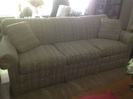 "Sofa is neutral colors of beige and off white. Measures 86"" long, 37"" deep and 32"" wide."