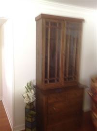 Vintage China cabinet.....has great straight lines.  Has that primitive look