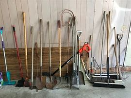 Many yard/garden tools including brooms, shovels, etc.