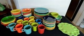 Fiesta dishes, cups, bowls for sale. There are more than shown in this photo.