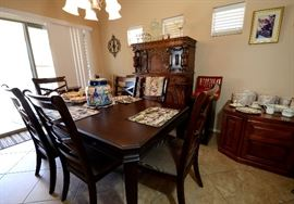 Ashley Dining Set with 6 chairs. It has a leaf and custom table pad. Receipt also of original cost.