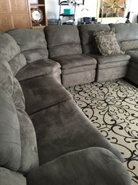 7 part sectional, lounger at one end, recliner on the other end