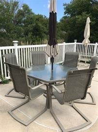 6 chairs, table, umbrella patio set (high end) Very very nice!