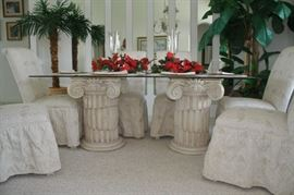 Heavy double pedestal base with glass top and 6 matching chairs. Like new. Matching placemats and napkins.