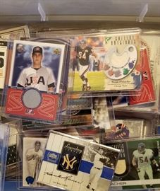 Relic Trading cards, each containing either pieces of a bat or pieces of athletes Uniform.
