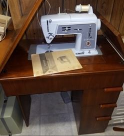 Vintage Singer sewing machine with beautiful cabinet!