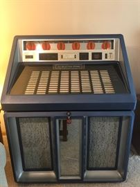 Juke box with records