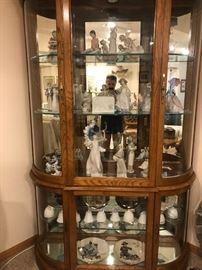 Curio cabinet and multiple lladro figurines/bells