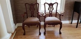 2 arm chairs belonging to dr  table