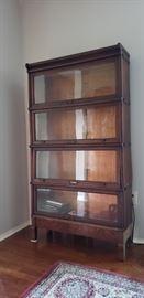 Modular oak veneer lawyers bookcase.  Original Sable Furniture Detroit tag attached.