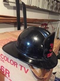 Vintage fireman's helmet side view