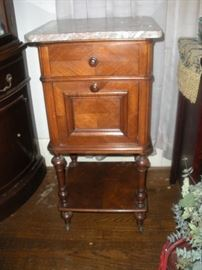 rose marble top commode she used as bedside table