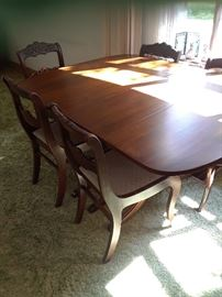 DR table set with 3 leaves, 6 chairs (1 captains) (wear to mid chair backs)