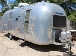 """1964, 24-foot Airstream """"radewind Land Yacht travel trailer in excellent condition.  All this needs is a fridge and it will be ready to take on the road.  The aluminum """"skin"""" is in remarkably good condition and can be polished to a high gloss.  This will not be half-price on Sunday.  Cash payment only. Update! We will be accepting bids on the Airstream with a reserve of $10,000.  Bids will be taken from the beginning of the sale on Thursday, September 20,  to the close of the sale, 3:00 pm on Sunday, September 23, or you can """"Buy It Now"""" for $20,000 at which time the bidding will end.  It will not go to half price on Sunday."""
