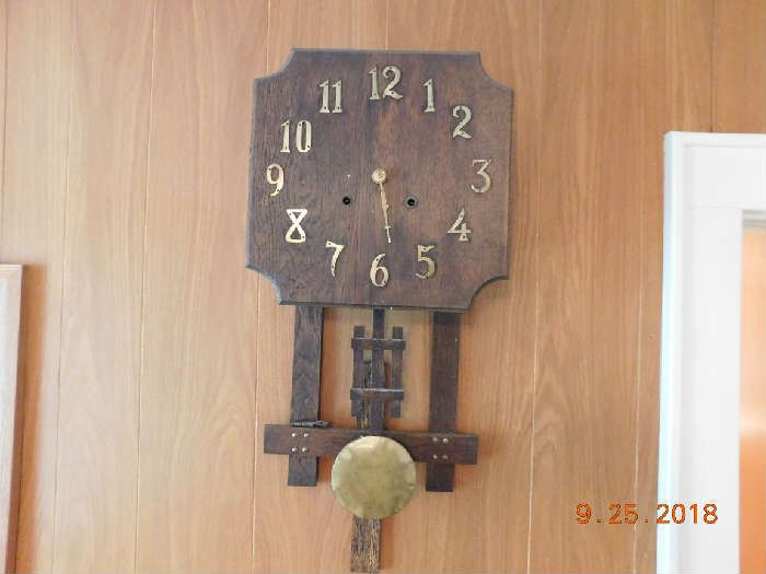 Old arts and crafts wall clock.