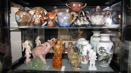 Large selection of Asain Pottery, sculptures, figurines.