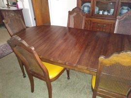 Matching dining room table with six chairs and two leaves