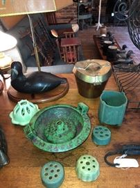 Weller Coppertone bowl with flower frog, a Cowan flower frog to back left and an interesting Arts & Crafts green vase with incised decoration