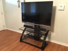 TV, TV stand and sound bar.