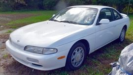 8PM: Estate Auto | 1995 Nissan 240SX Coupe with 71,392 Miles; 5-speed Manual Transmission; AM/FM Stereo with CD; Power Windows, Locks, Mirrors; White Exterior, Slate-Blue Cloth Interior, and much more. VIN: JN1AS44D2SW007019