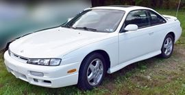 8PM: Estate Auto | 1997 Nissan 240SX SE Coupe with 32,556 Miles; 5-speed Manual Transmission; Power Moonroof; Power Locks, Windows, Mirrors; AM/FM Stereo with Cassette; White Exterior, Black/Gray Sport Cloth Interior, and more. VIN: JN1AS44D6VW100808