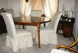 upholstered white chairs   there are 4 of them                            BUY IT NOW  $ 30.00 each