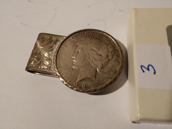 Silver dollar and sterling money clip
