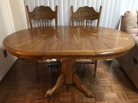 Solid oak table with 1 leaf & 4 chairs