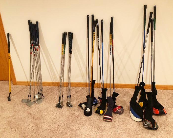 Several sets of golf clubs. Callaway, Cobra, Mizuno, Taylormade, PING