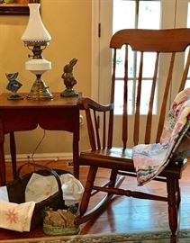 1760s Queen Anne Period Stand Table w/ Formed Skirt, Antique Rocking Chair, Little Girl Door Stop, Drayton Bunny Door Stop, Electrified Milk Glass Lamp, Splint Gathering Basket, Embroidered Linens, Hand Sewn Patchwork Quilt