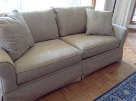 A close up shot of the Beige Sofa