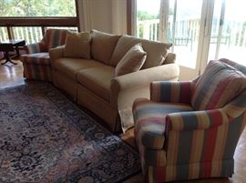 Beige Sofa and 2 Striped Chairs and a Karastan area rug