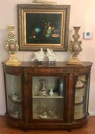 A similar display cabinet, only taller and rectangular, is also available