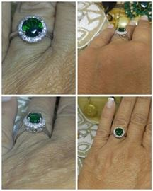 Fine lab created emerald surrounded by AAA brilliant zircons set in sterling silver