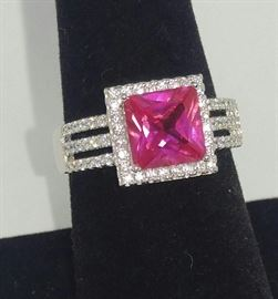 Pink Lab created Princess cut Sapphire in sterling silver surrounded by AAA European Zirconia all hand set size 8