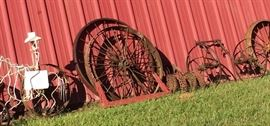 Closer Look at Some of the Wagon Wheels of Different Sizes and Types, Yard Art, Planters, Vintage Rusty Farm Equipment, Red Tractor Seat Stool & More!