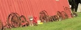 Closer Look at Some of the Wagon Wheels of Different Sizes and Types, Yard Art, Planters, Vintage Rusty Farm Equipment, Red Tractor Seat Stool, Iron Bed Headboards & More!