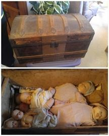 Antique some trunk & some vintage dolls underneath the tray