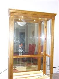 Beautiful antique lighted curio.