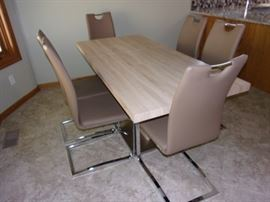 Vintage look chop-block style laminate table with one leaf and 6 chairs.  Chairs are pleather, MCM style.