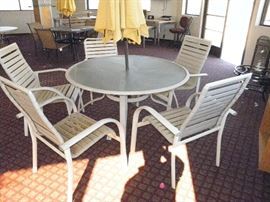 52 inch aluminum / glass top patio table and 5 commercial stacking chairs *******$75********* Call now for appointment...(760) 788-0775   ...(760) 445-8571