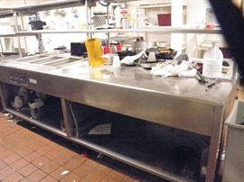"""WELLS""    Stainless commercial kitchen 3 well prep table with infra red warming shelves up top and full sheving underneath....10 feet long...from working installation *******$400*********   Call Now!  (760) 788-0775   (760) 445-8571  Photo #1....see next photo...shows control knobs"
