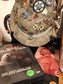 German hat with loads of pins and WWII historical books.