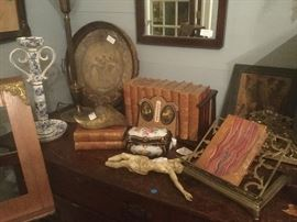 Collection of Dickens books, crucifix