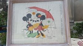 1931, MICKEY MOUSE, Colored, Embroidered Pillowcase  by Vogart Needlecraft, Mickey Mouse Series #98, Introduced in 1932. Vogart made this line of fabric patterns for Disney Fabric: aprons, laundry bags, pillowcases, etc.  This is a nice piece, mounted under glass.