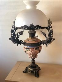 Antique oil lamp by Fusco's Enshede B.V. Enschede Holland