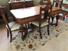 Antique table on rollers with 2 leafs