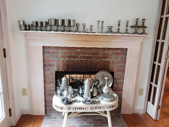 Pewter goblets, candleholders, decanter, tea and coffee sets w/ trays.